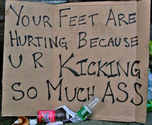 feet hurt marathon sign